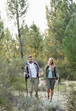 Full length of a fit couple exploring the woods
