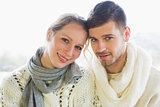 Close up portrait of a loving couple in winter clothing