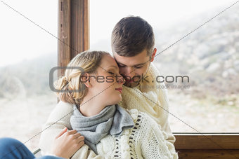 Close up of a loving young couple in winter clothing