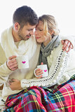 Loving couple in winter clothing with coffee cups