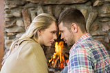 Romantic young couple in front of fireplace