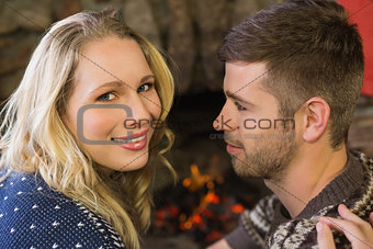 Close up of a romantic couple in front of fireplace