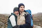 Fit loving couple on a hike in the countryside