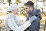 Loving couple looking at each other in winter wear outdoors