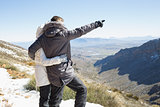 Couple in jackets looking at mountain range
