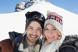 Close up portrait of a smiling couple in woolen hats