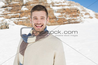 Portrait of cheerful man on snow covered landscape