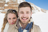 Loving couple on snow covered landscape