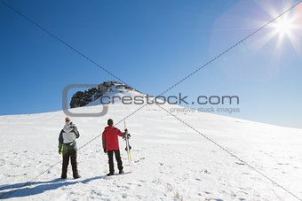 Skiers on snow covered landscape on a sunny day