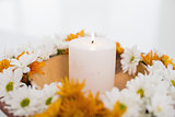Flowers and a lit candle