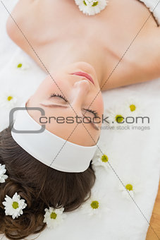 Beautiful woman with eyes closed in beauty salon