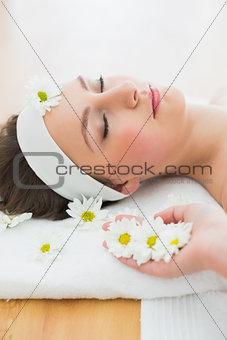 Beautiful woman lying on massage table in beauty salon