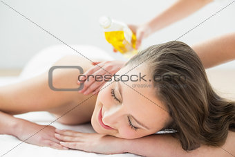 Close up of beautiful woman enjoying oil massage