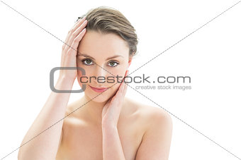 Close up of a beautiful young woman touching her face