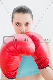 Close up of beautiful woman in red boxing gloves