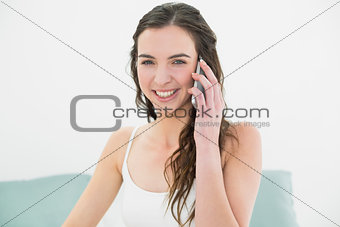 Portrait of relaxed woman using mobile phone