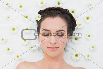 Beautiful woman with flowers in beauty salon