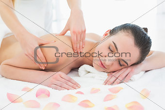 Beautiful female enjoying back massage at beauty spa
