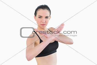Fit young woman standing in defending posture