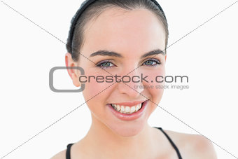 Close up portrait of a sporty young woman smiling