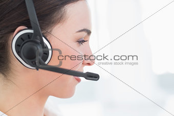 Close up side view of businesswoman wearing headset