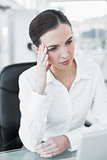 Worried businesswoman with laptop at office