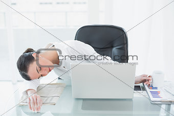 Tired young businesswoman resting in office