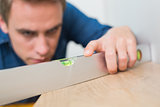 Close up of handyman using a spirit level