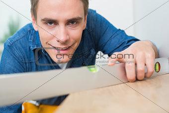 Close up of a handyman using a spirit level