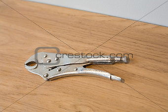 Pliers on wooden surface