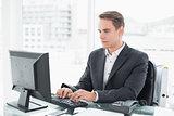 Businessman using computer at office desk