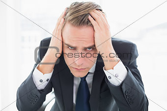 Close up of a worried businessman at office