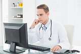 Doctor using computer at medical office