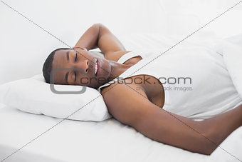 Afro man sleeping in bed