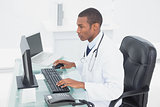 Concentrated doctor using computer at medical office