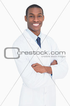Portrait of a smiling male doctor with arms crossed