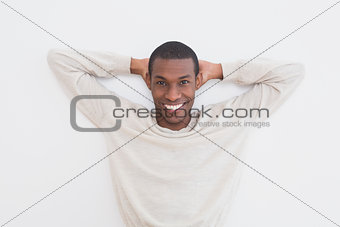 Casual Afro young man against a wall