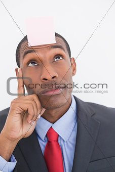 Afro businessman with blank note on forehead