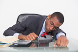 Afro businessman resting at desk over white background