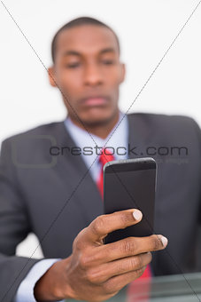 Portrait of an elegant young businessman text messaging
