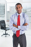 Elegant serious Afro businessman in office