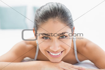Close up portrait of a pretty woman lying in bed