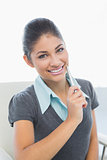 Close up of smiling businesswoman holding pen in office