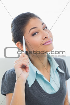 Close up of a smiling businesswoman holding pen