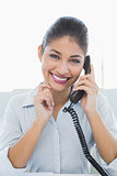 Portrait of a cheerful businesswoman using telephone