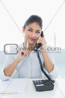 Portrait of an elegant businesswoman using telephone
