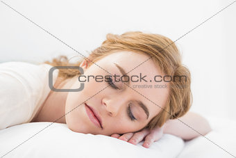 Close up of a pretty woman sleeping in bed