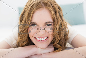 Close up portrait of a pretty woman in bed
