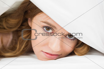 Close up of a pretty woman resting in bed