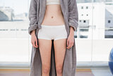 Mid section of woman in shorts and bathrobe